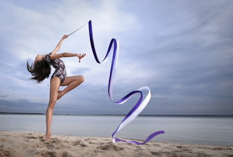 20150516th-woman-beach-sand-shoreline-water-lake-rhythmic-gymnastics-shutterstock_94545109-2